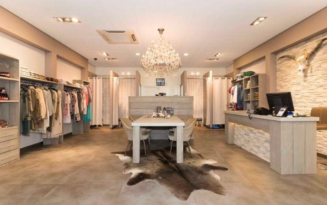 Inrichting kledingwinkel Lupo Collina | Realistische 3D ...